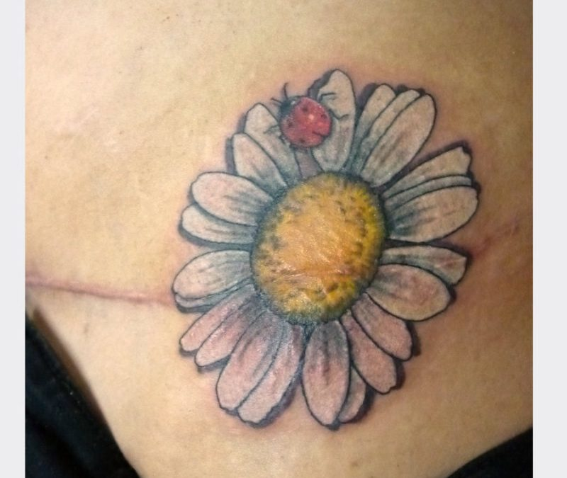 Daisy flower n ladybug tattoo image