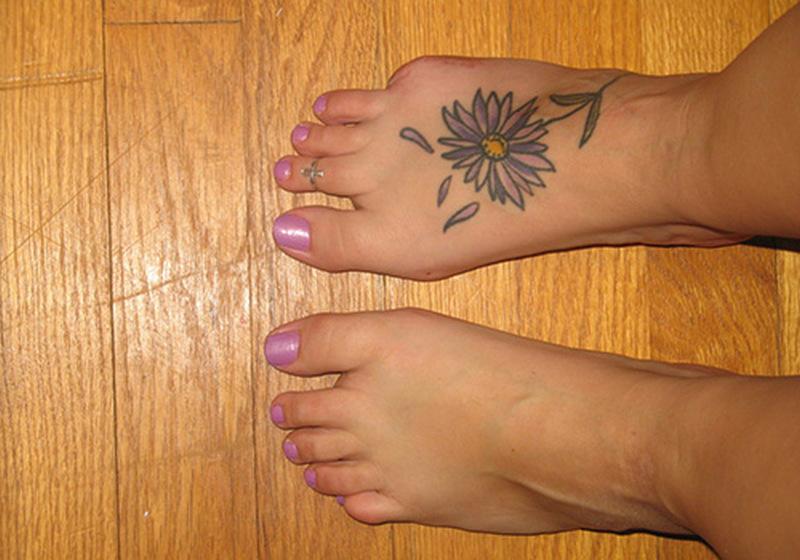 Daisy tattoo on right foot