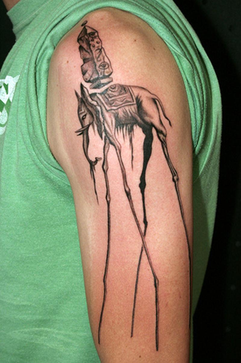 Dali elephant tattoo on sleeve