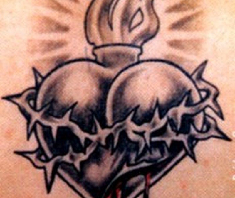 Dark barbed heart tattoo design