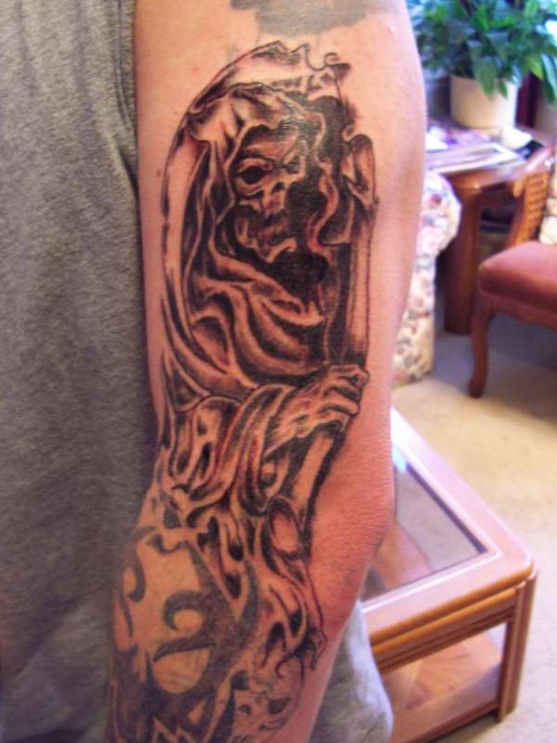 Dark grim reaper tattoo on elbow