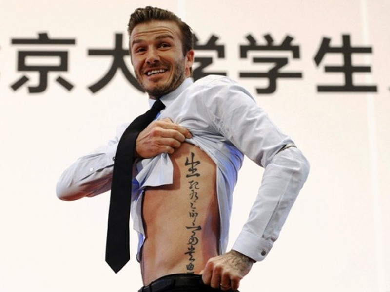 David beckham showing asian tattoo