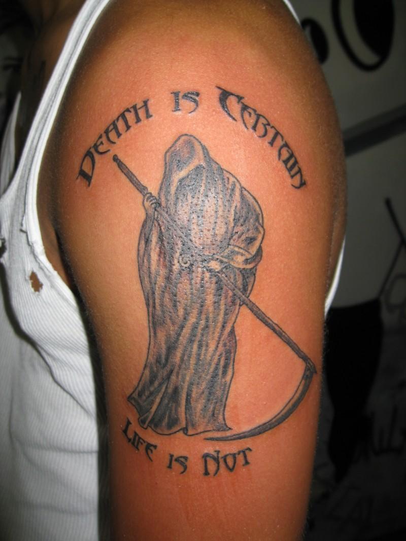 Death grim reaper tattoo on biceps