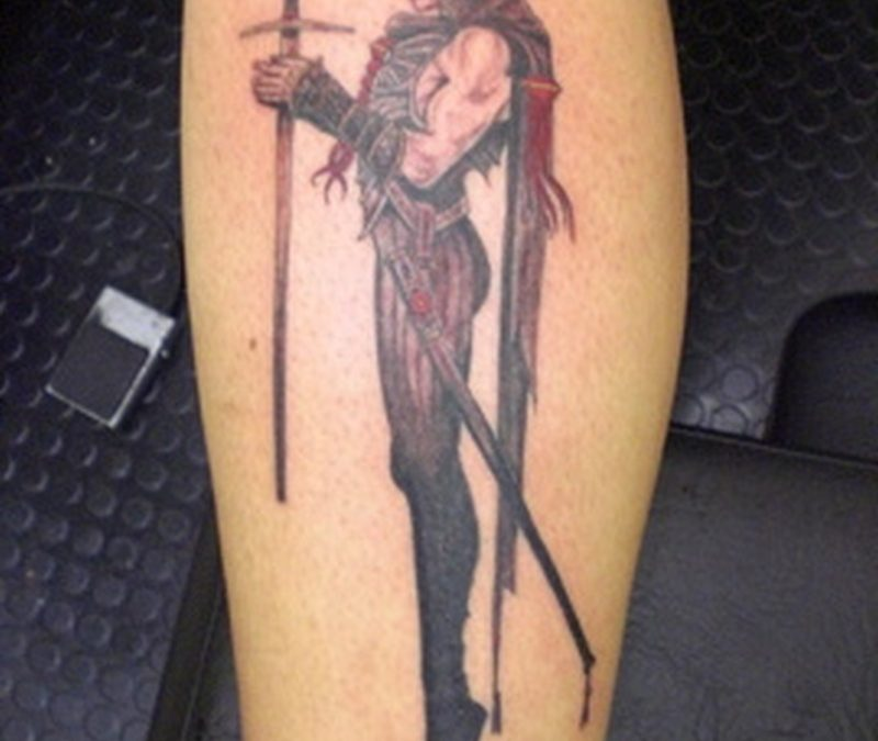 Death woman holding sword tattoo on skin