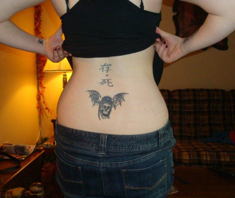 Deathbat chinese symbols tattoo on lower back