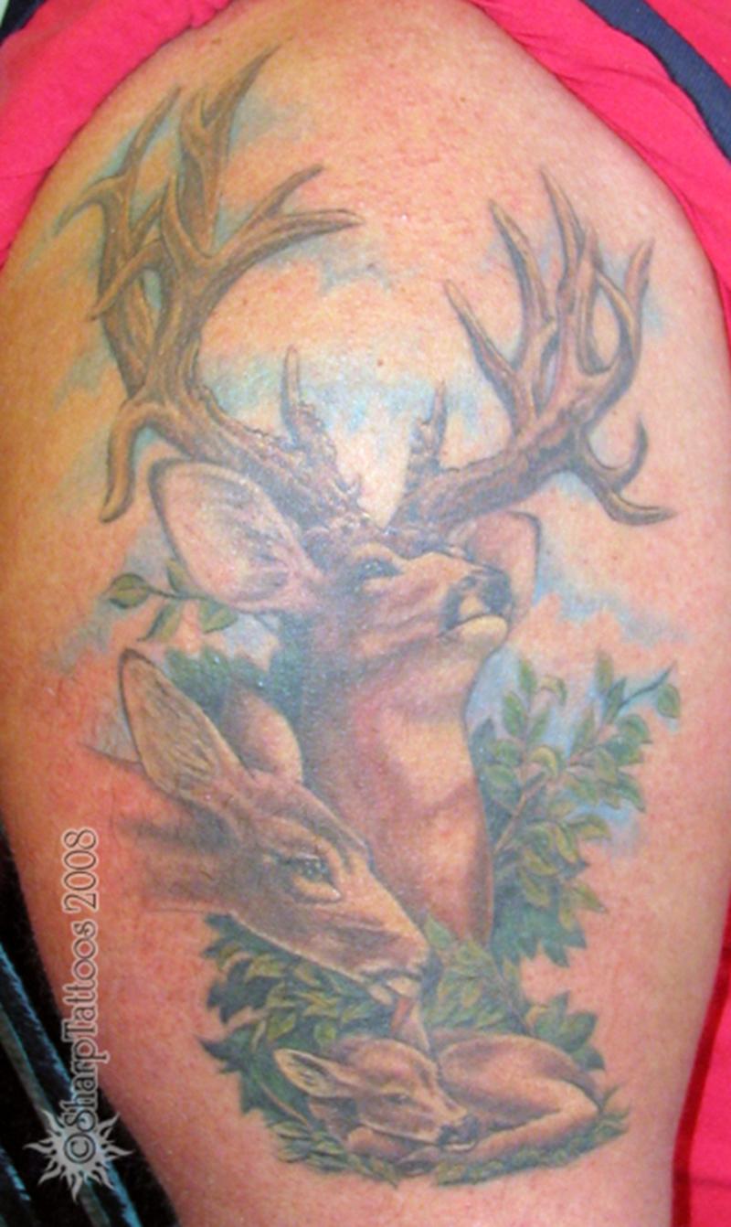 Deer family tattoo design on biceps