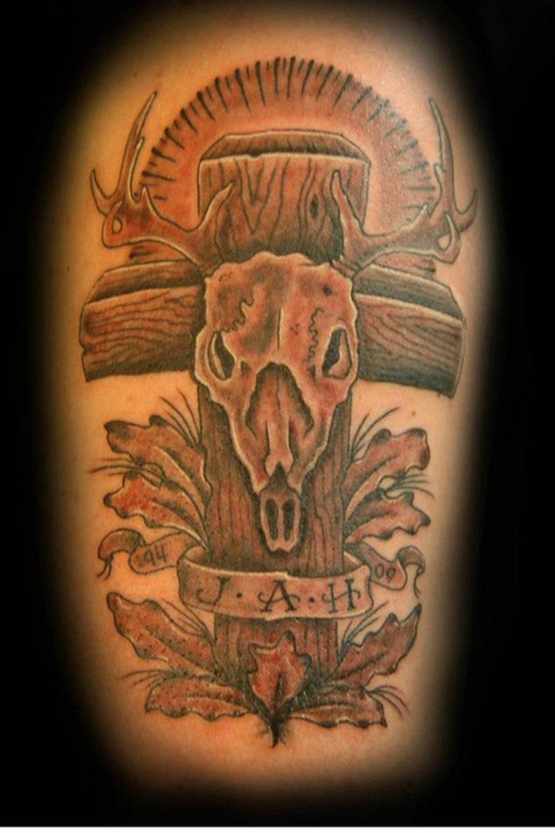 Deer skull cross tattoo design
