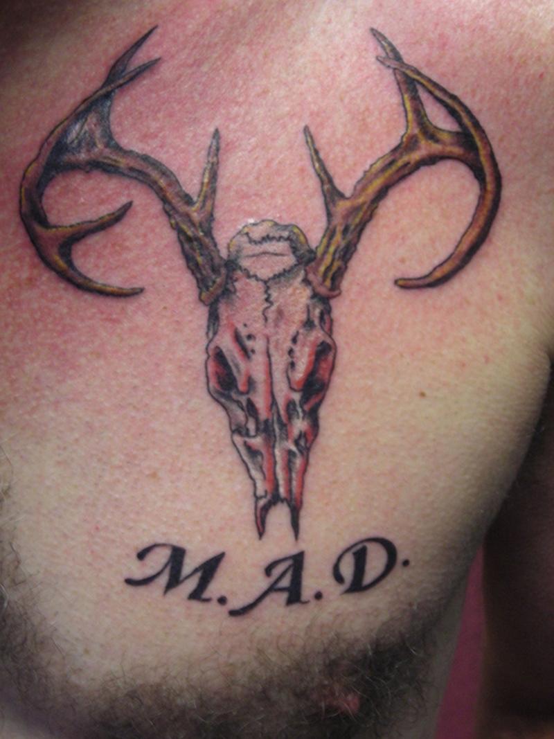 Deer skull tattoo on chest
