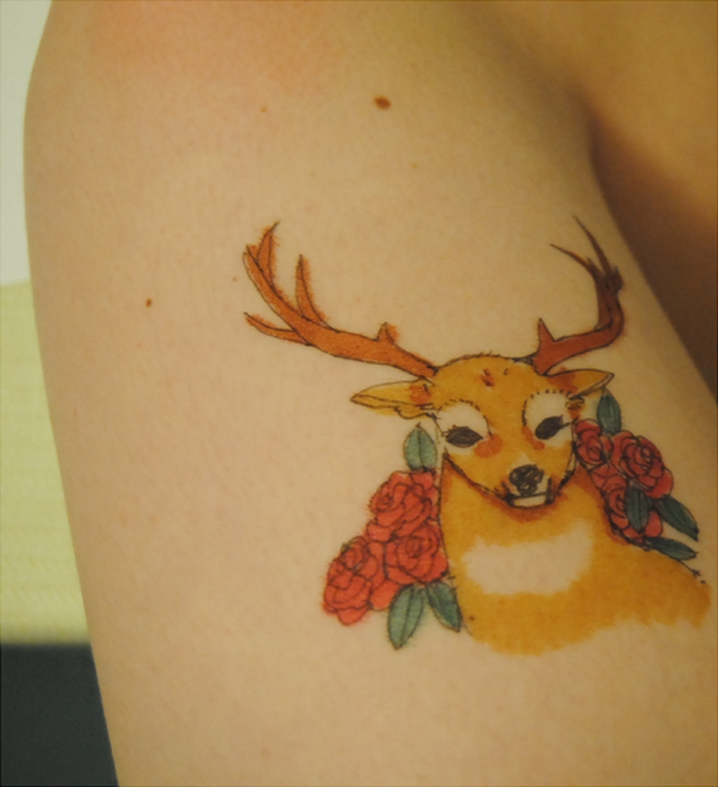 Deer tattoo design on biceps