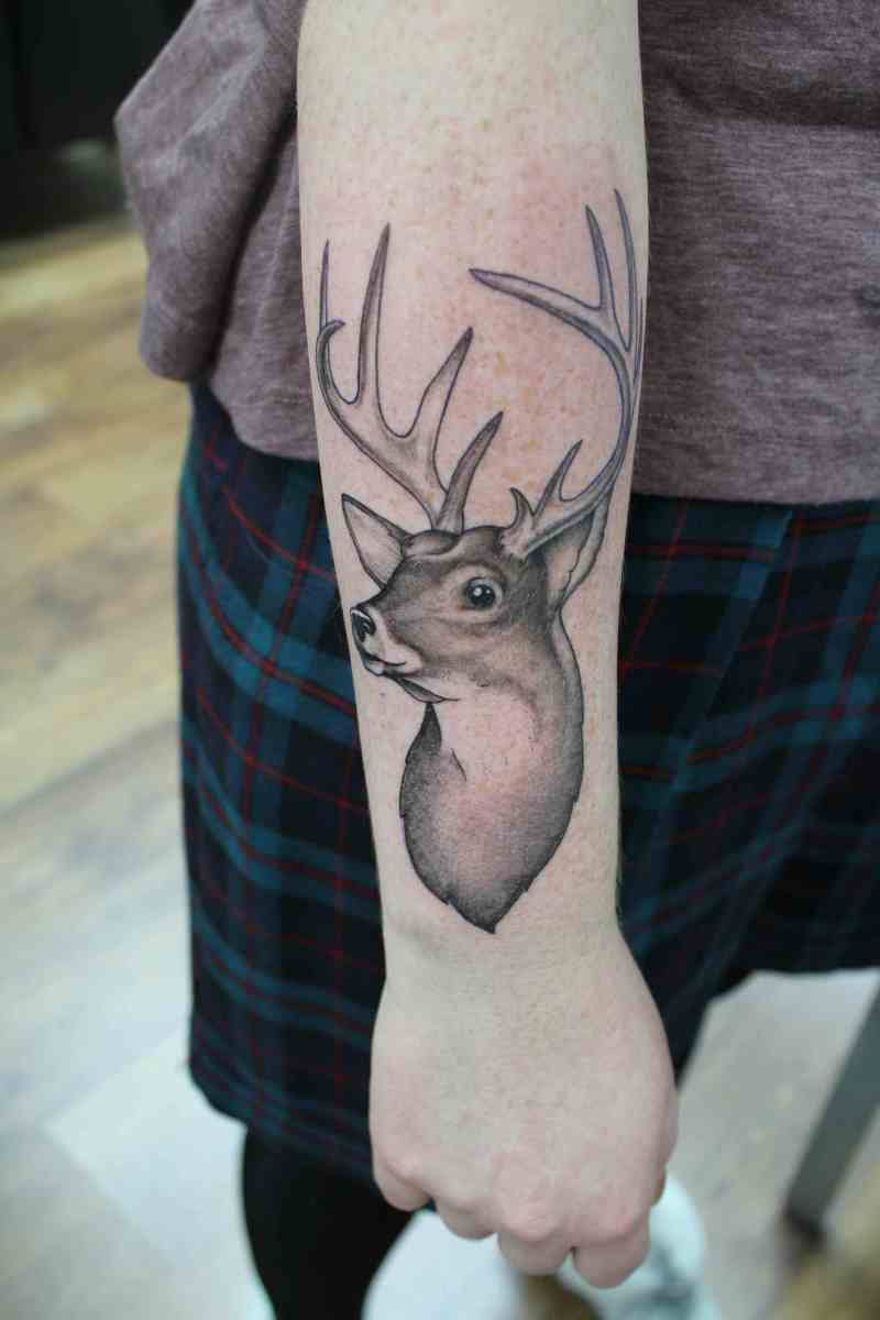 Deer tattoo on wrist