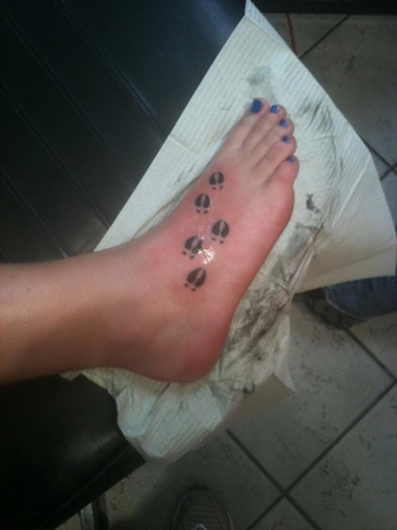 Deer track tattoo on foot