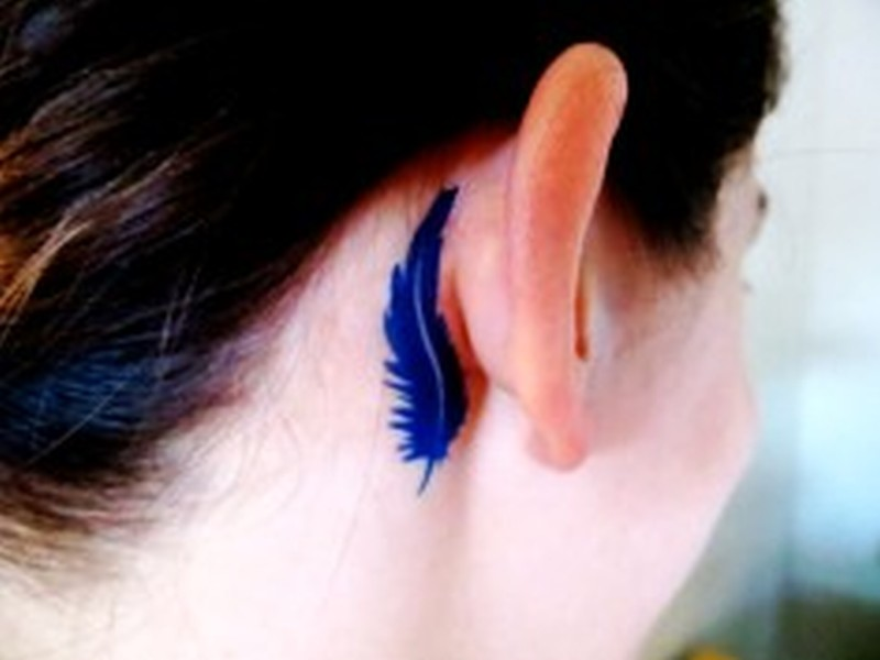 Demi lovato inspired feather ear tattoo design