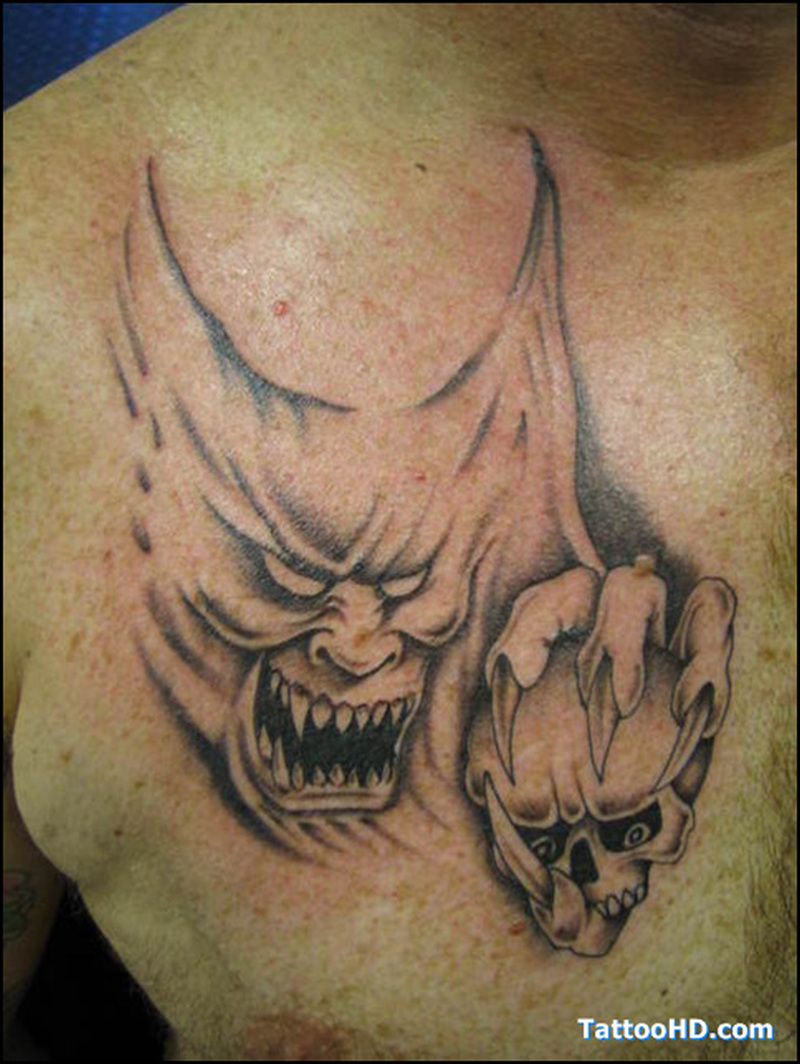 Demon face tattoo on chest