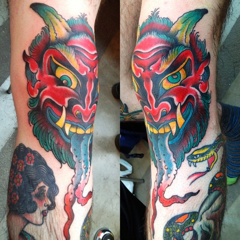 Demon head knee tattoo design