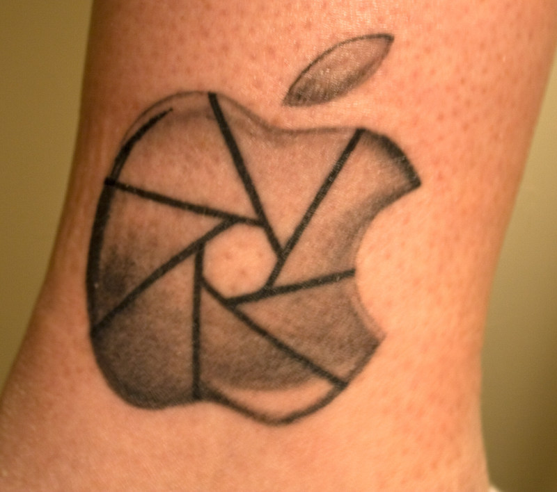 Derek apple tattoo