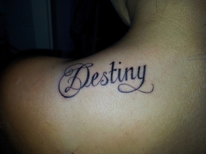 Destiny ambigram tattoo on shoulder