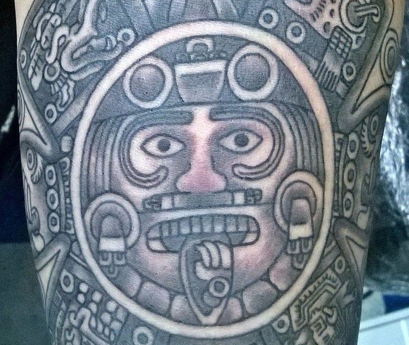 Detailed stone sun god aztec tattoo