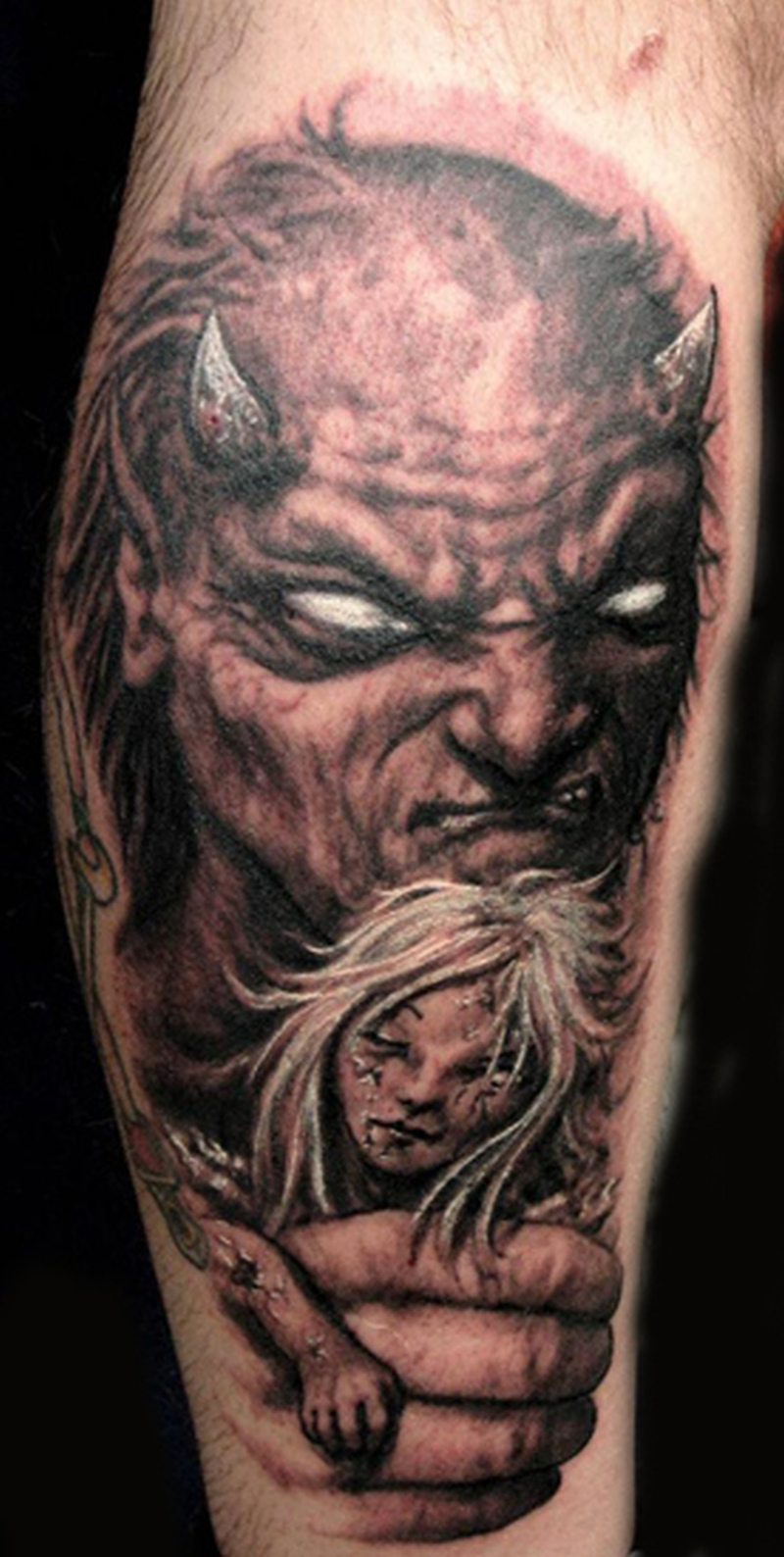 Devil with girl tattoo design