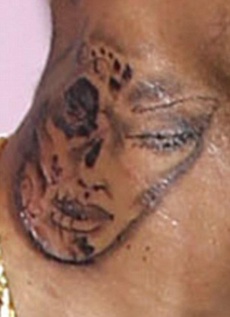 Dia de los muertos face tattoo on neck