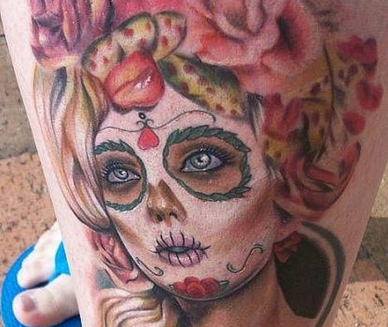 Dia de los muertos girl tattoo on left leg