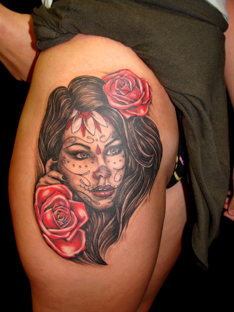Dia de los muertos girl tattoo on right thigh