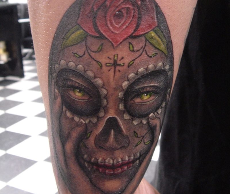 Dia de los muertos lady skull tattoo on wrist