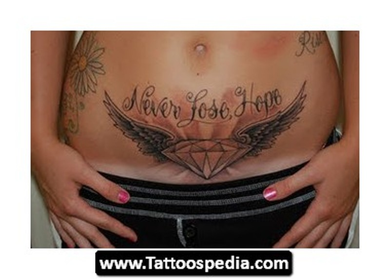 Diamond angel wings tattoo on belly