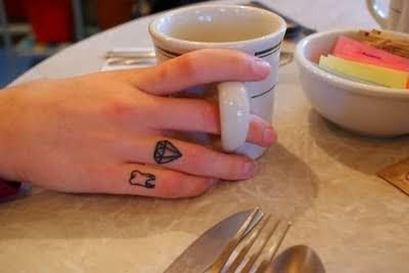 Diamond n teeth tattoo on finger
