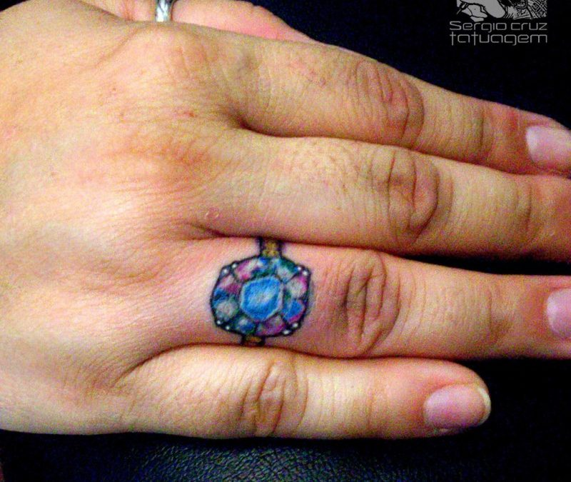 Diamond ring tattoo on finger