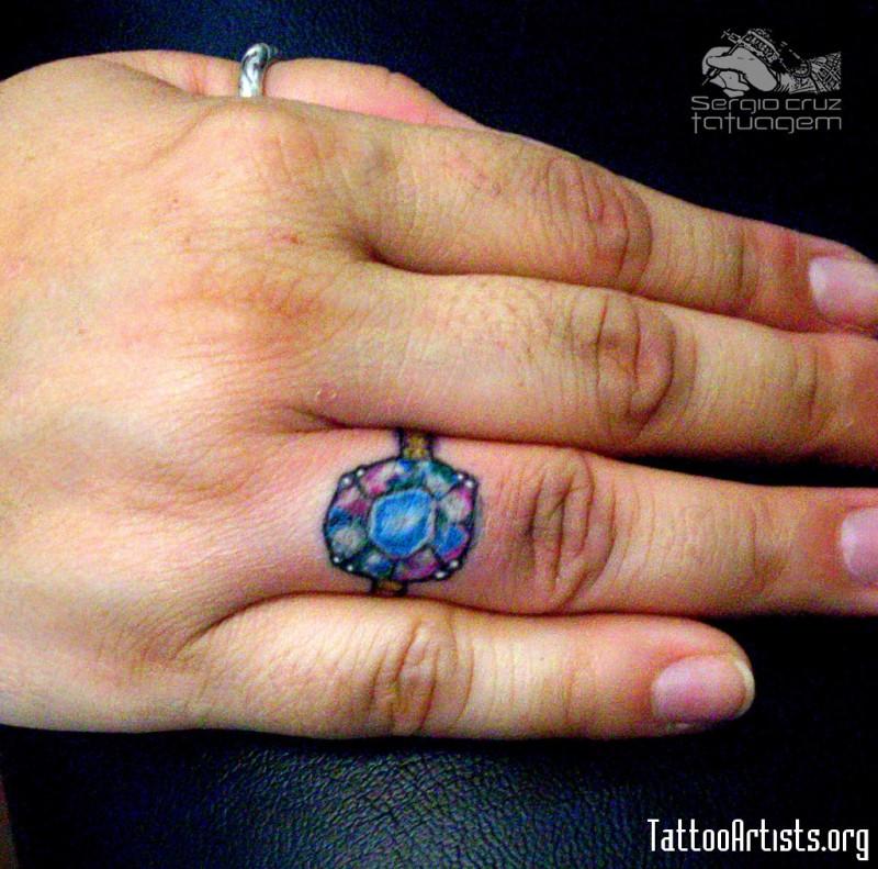 Diamond ring tattoo on finger