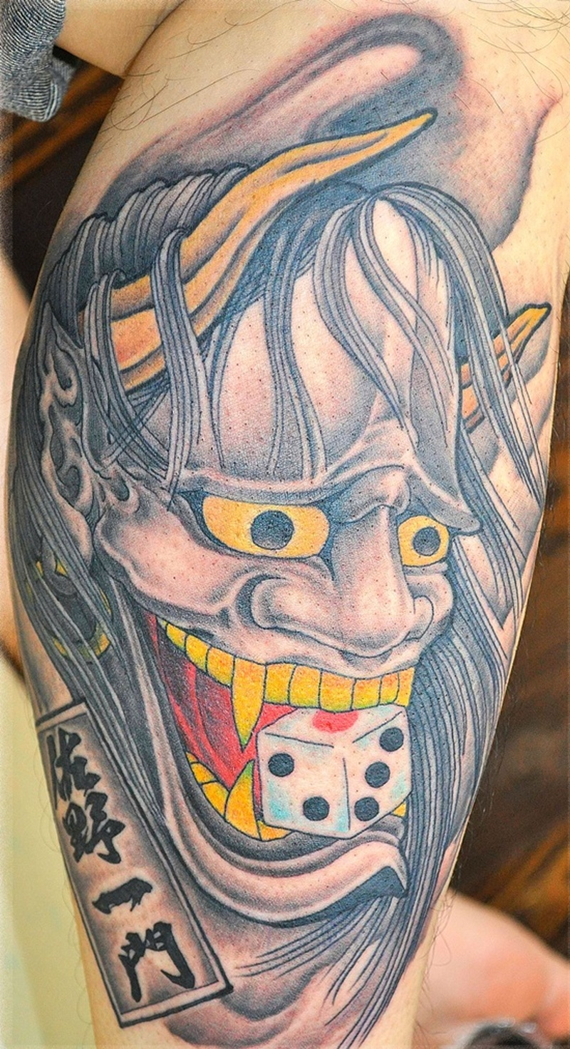 Dice in devil mouth tattoo design