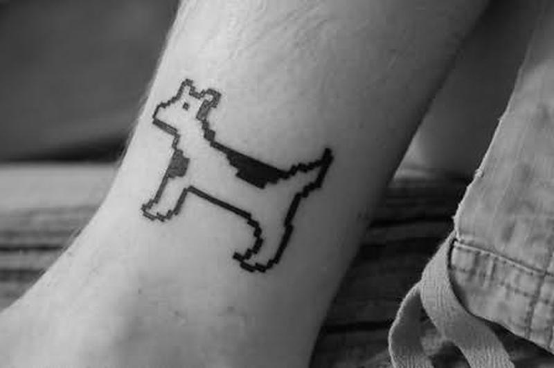 Dog geek tattoo on ankle