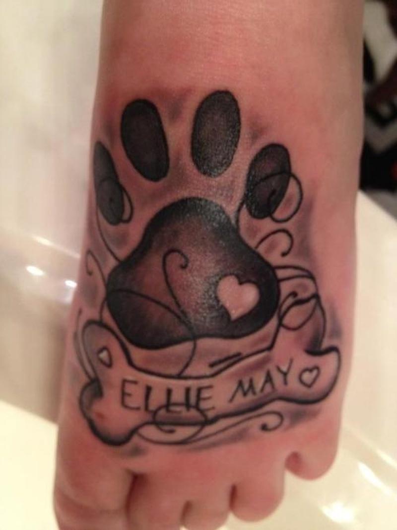 Dog paw print tattoo on foot 2