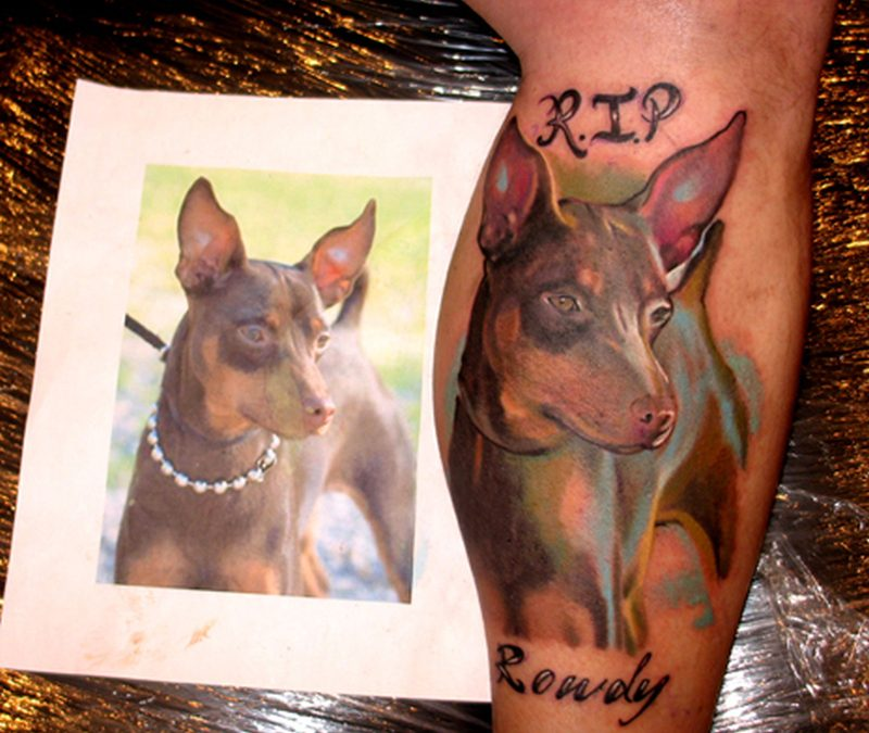 Dog tattoo on leg