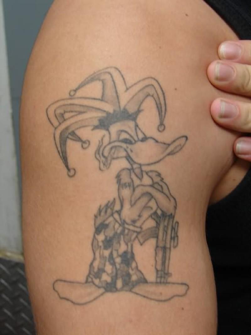 Donald duck cartoon tattoo on biceps
