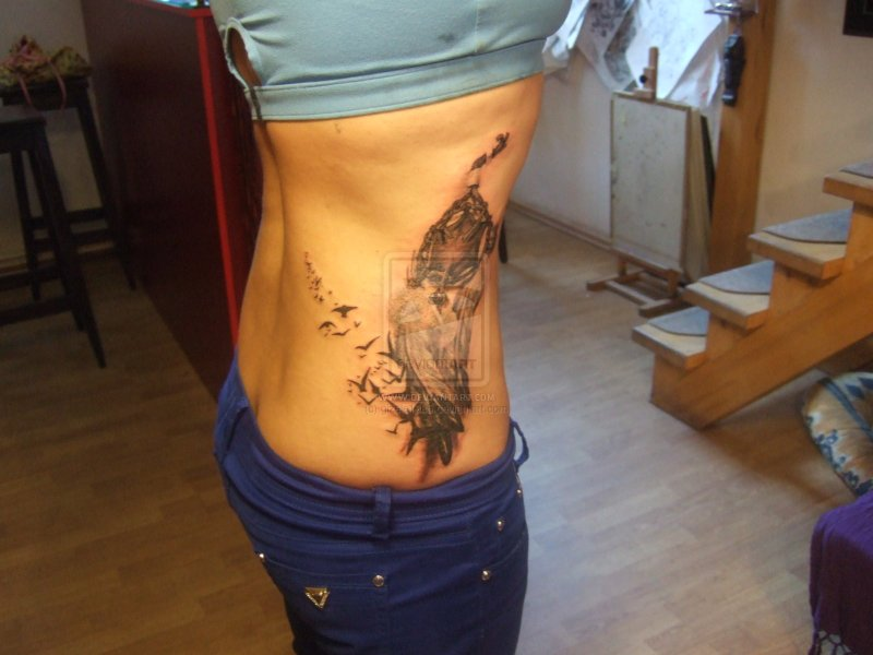 Dream catcher tattoo on ribs for girls 2