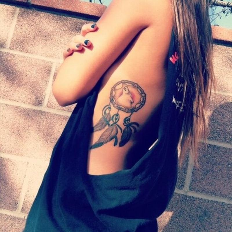Dream catcher tattoo on ribs