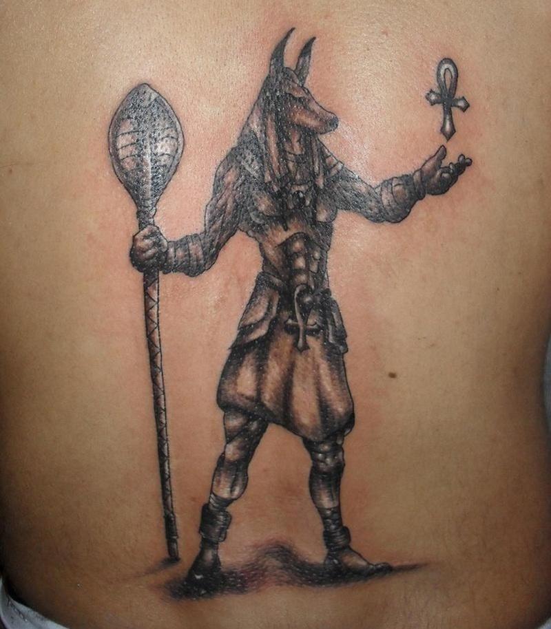 Egyptian anubis tattoo on the back - Tattoos Book - 65 000