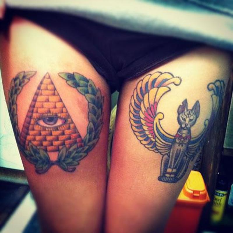 Egyptian eye n cat tattoo design on thigh