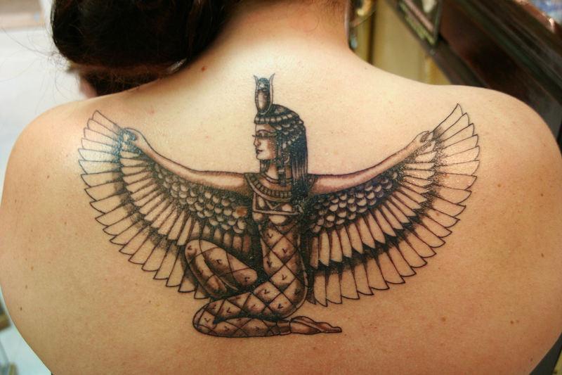 Egyptian tattoo design on upper back for girls