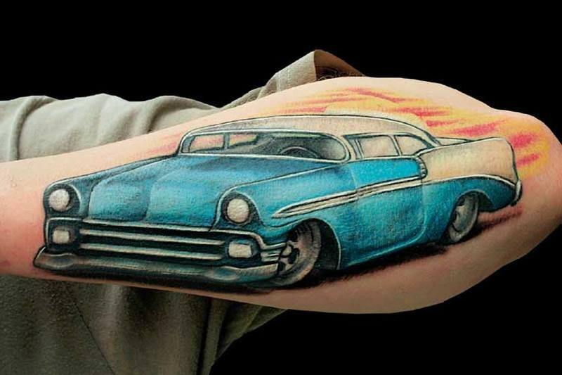 Elegant car tattoo on forearm