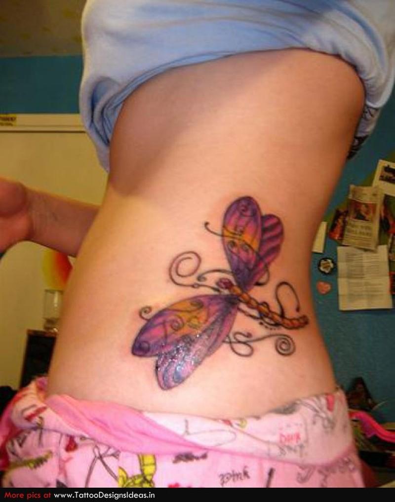 Elegant dragonfly tattoo on waist