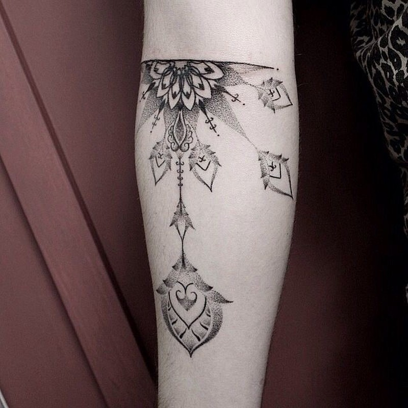 Elegant floral patterns forearm dotwork tattoo