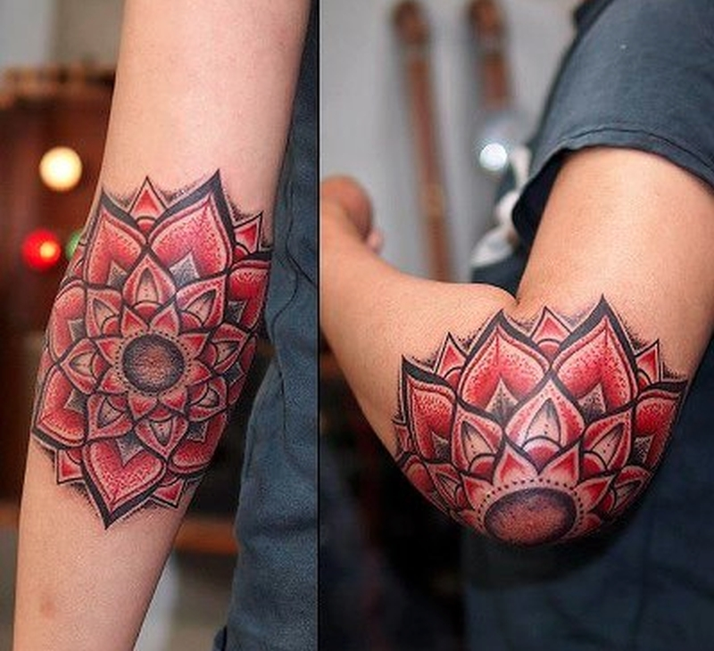 Elegant lotus flower tattoo on elbow
