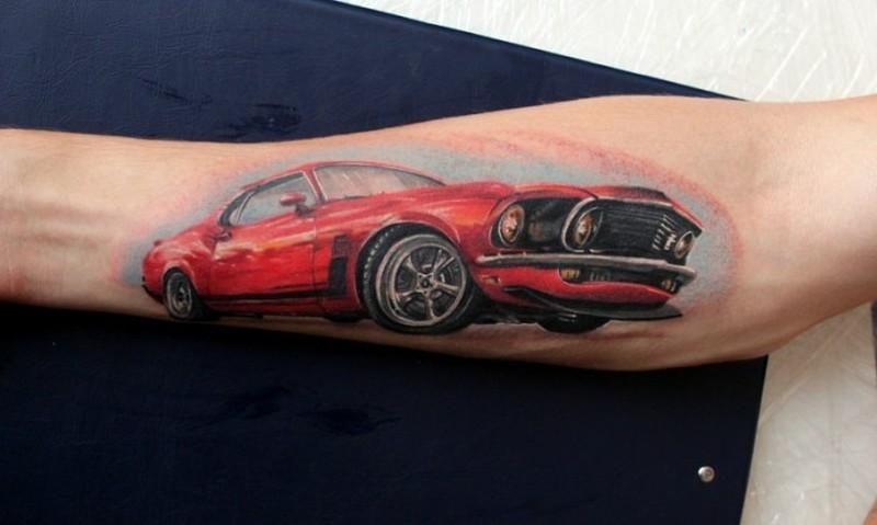 Elegant red car tattoo on forearm