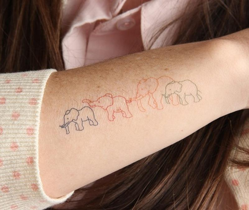 Elephant family tattoo design near wrist