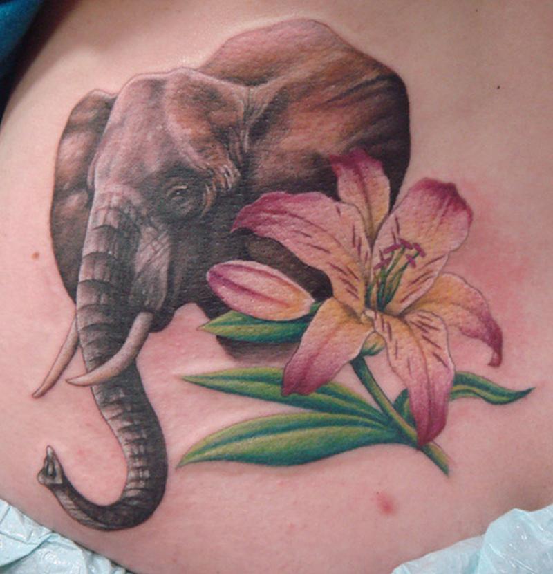 Elephant n lily flower tattoo design
