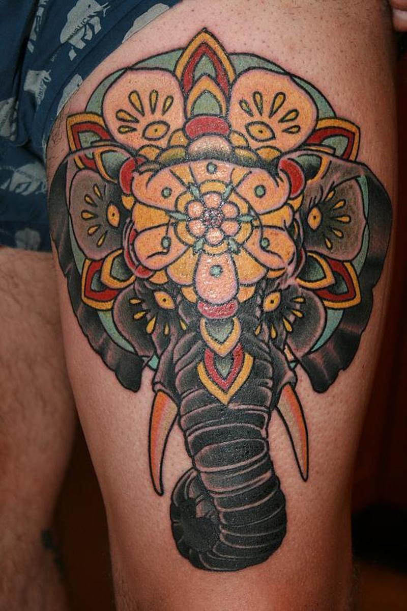 Elephant tattoo design on left thigh