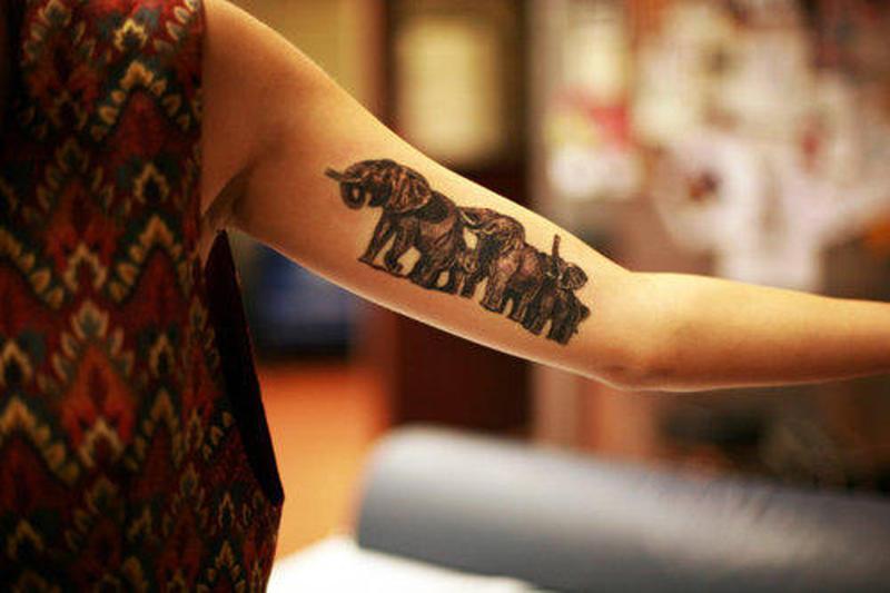 Elephant tattoo on muscles