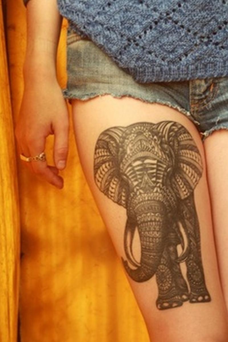 Elephant tattoo on right thigh